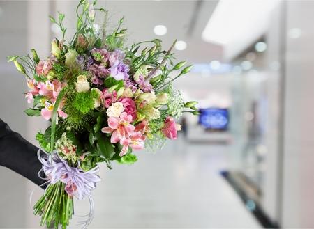 Hand Giving a Flower Bouquet