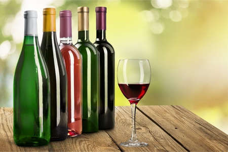Red wine bottle and glass, isolated on white background