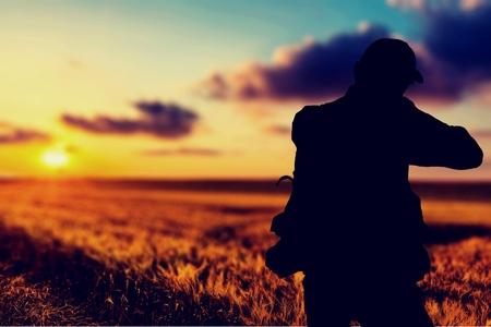 Turkey hunter silhouette at sunset Stock Photo