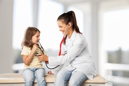 Female doctor examining success child with finger up Reklamní fotografie