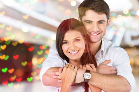 Portrait of happy couple isolated on white background. Attractive man and woman being playful.