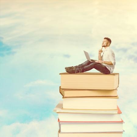 Man using laptop on the books