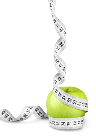Body Measuring Tape Around A Green Apple