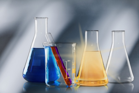 Laboratory glassware containing colorful chemical Stock Photo