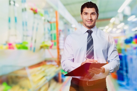 Portrait Of Manager In Warehouse With Clipboard Stock Photo