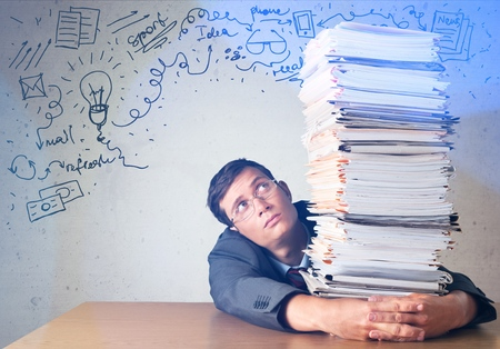 office worker holding paperwork stack Imagens