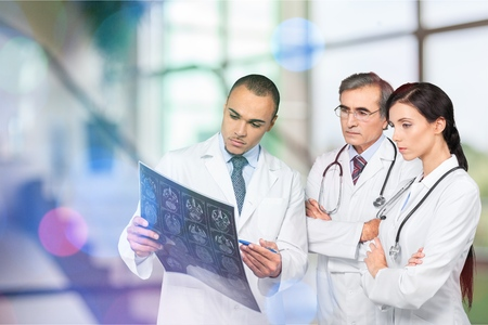 Serious doctor with touchpad. Stock Photo