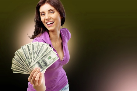 Excited Young Woman Holding Money 스톡 콘텐츠
