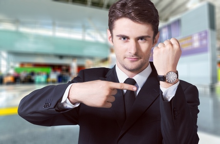 Businessman showing the time on his wrist watch Stock Photo