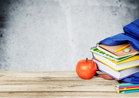 school backpack full of stationery isolated on white background Stock Photo