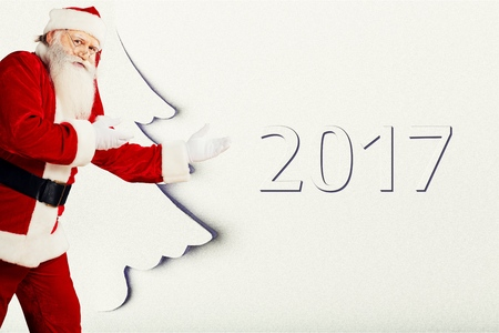 Santa showing anything isolated on white