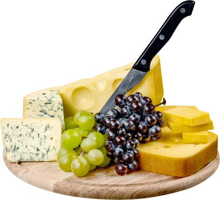 Various Kinds of Cheeses, Grape, Bread and Knife on the Wooden Platter - Isolated Stock Photo