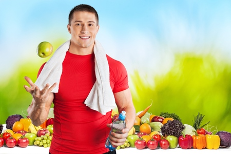Man with vegetables Stock Photo