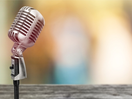 Microphone on abstract blurred of speech in seminar room or speaking conference hall light, Event Background
