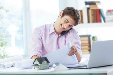 architect working at his laptop on the office Banco de Imagens - 97282545