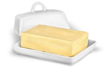 Butter on white Stock Photo