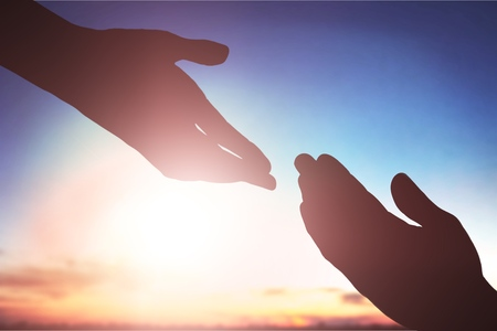 Help hand concept on sky background Stock Photo