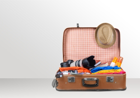 Travel bag on wooden Stock Photo