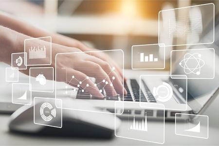 Woman typing computer Standard-Bild