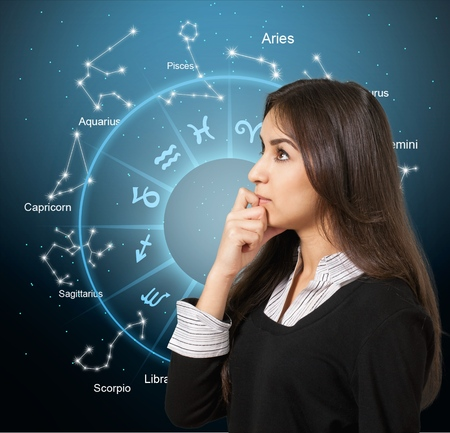 Woman think of a horoscope