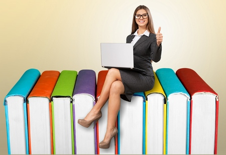 beautiful businesswoman sitting on big 3d chart with laptop Stock Photo