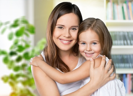 happy family. Mother and baby daughter plays at home on the sofa Stock Photo