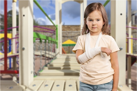 little boy in a cast.child with a broken arm. funny kid after accident. Stock Photo