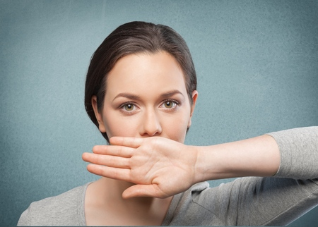 young girl crying with her hand covering her mouth Stock Photo