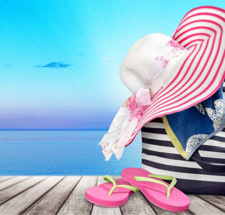 straw hat and  basket for beach isolated on white background