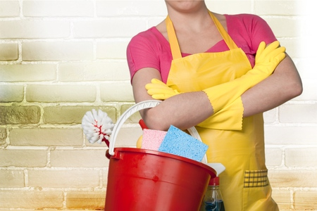 Maid holding cleaning bucket on White