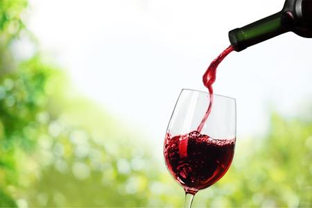 Red wine pouring in glass Archivio Fotografico