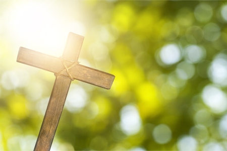 Cross on nature green background Standard-Bild