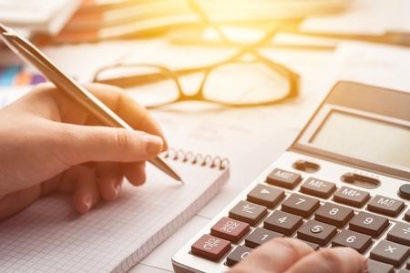 Woman hand working on calculator