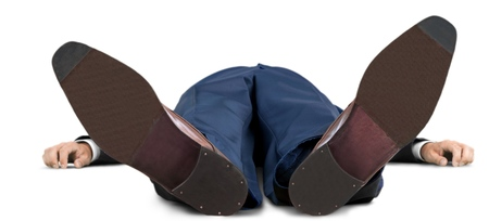 Portrait of a Businessman Lying Flat on his Back Stock Photo