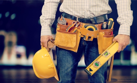 Worker and professional builder with tools