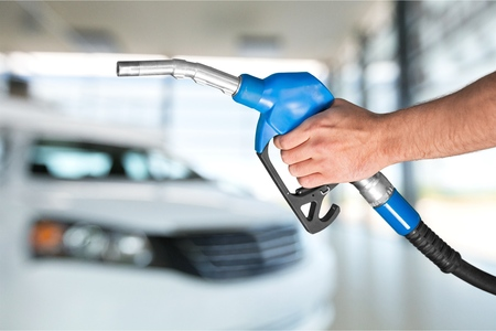 holding a gas nozzle