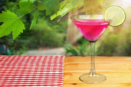 Classic Cosmopolitan Drink with Lime Decoration - Cocktail Glass Reklamní fotografie