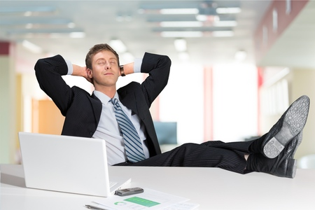 business man or office worker daydreaming with feet on table Stock Photo