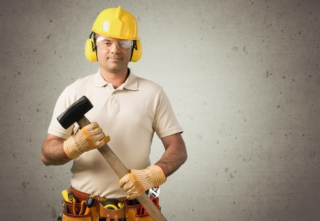 Carpenter Contractor Man Wearing Gogles Toolbelt Hardhat Isolated on White Foto de archivo