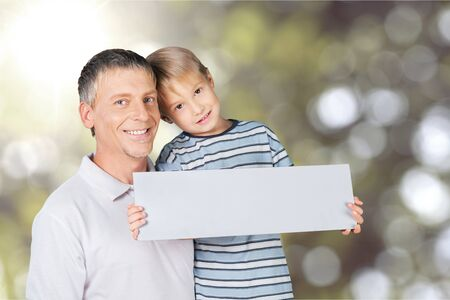 Business owner and son holding an open sign Stock Photo