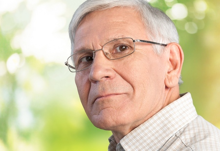 Portrait of a happy senior man isolated against white
