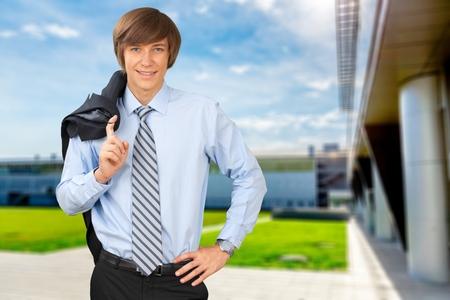 Businessman smiling with his jacket over shoulder