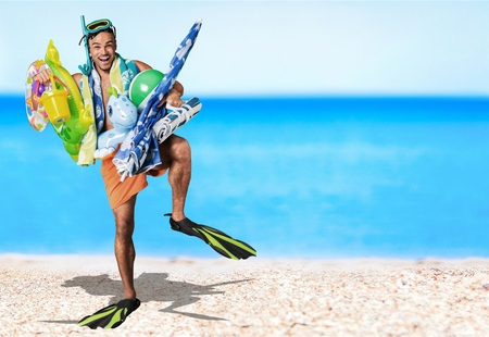 Caucasian swimmer with mask, snorkel and flippers over white background