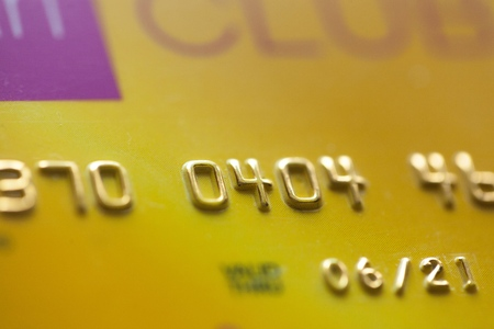 Credit Card Number Closeup. Banking and Transaction Technology. Credit Card in Macro Photography.