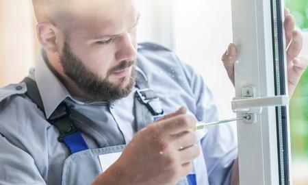 The worker repairs the window