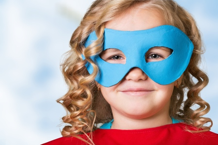Superhero child on sky background Foto de archivo