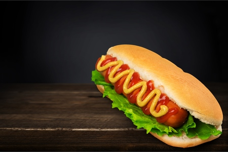 Big hotdog with sausage tomatoes, mustard and 版權商用圖片