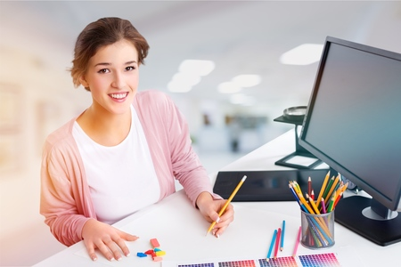 Female designer works with computer Stock Photo