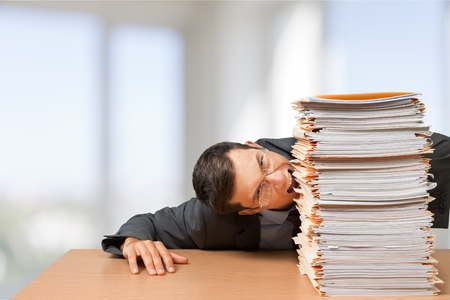 Man Surrounded by File Folders