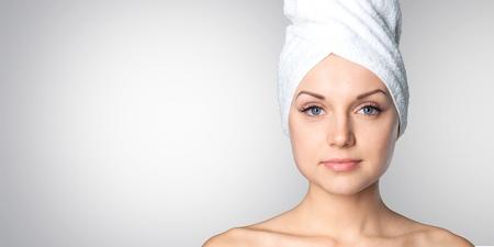 woman with towel on her head Фото со стока